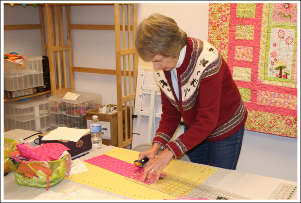 Sandy cutting her fabric.