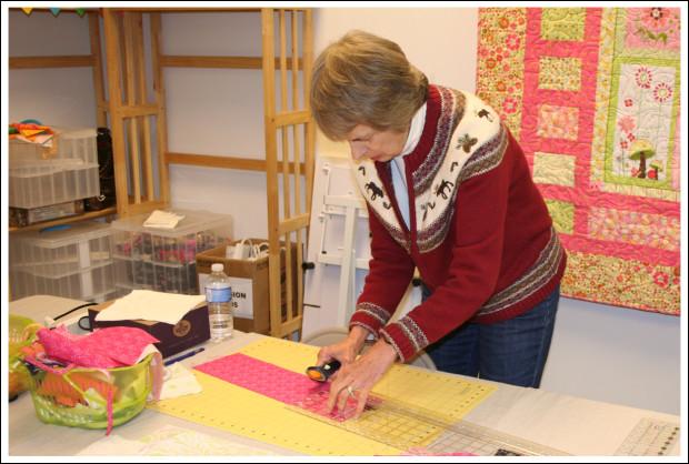 Sandy cutting her fabric.