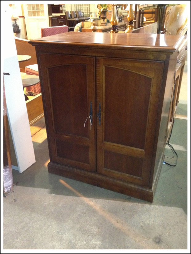Cherry-finish armoire.