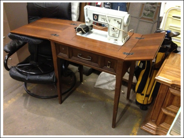 Singer sewing machine and table.
