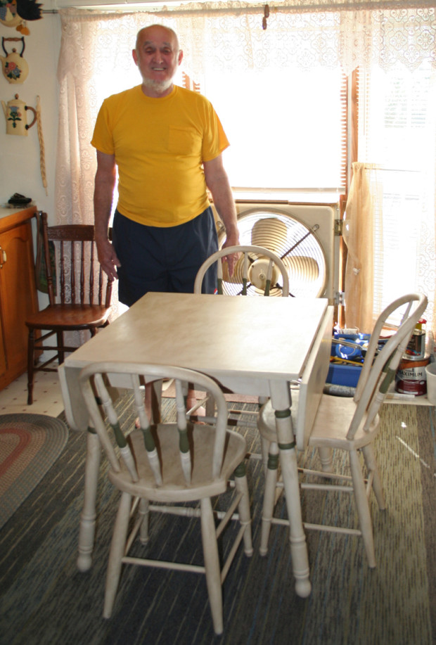 Dad with his new dining set.