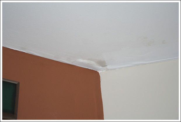 Water damage just outside of bedroom.