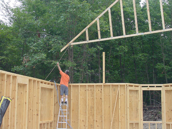Installing the roof trusses and sheathing for Roof trusses installation